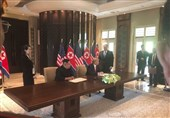 Trump, Kim Sign Document at End of Summit