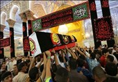 مراسم تشییع پیکر شهدای عراقی که توسط جنگدههای آمریکایی شهید شدند+فیلم