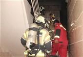 نجات 13 مرد و زن محبوس شده میان دود و آتش + تصاویر