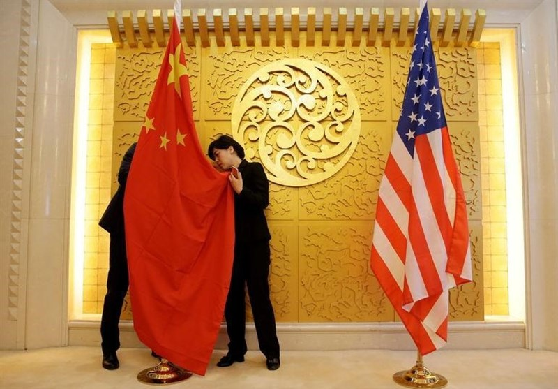 China, US Officials Engage on Trade While Huawei Row Burns