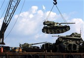 Lebanon dumps armored vehicles into Mediterranean