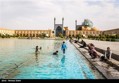 Children Playing with Water in Isfahan Naqsh-e Jahan Square