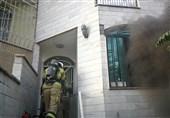 نجات 11 ساکن ساختمان گرفتار شده میان دود غلیظ + تصاویر