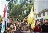 حرکة النجباء تنظم وقفة تضامنیة امام سفارة ایران فی دمشق