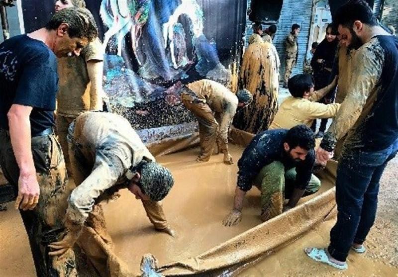 اجلاس جهانی پیرغلامان حسینی - خرمآباد|آئین گِل مالی لرستان رونمایی و ثبت ملی شد+تصاویر
