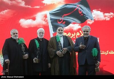 تجلیل از پیر غلامان اهلبیت در آیین اهتزاز پرچم 1000 متری یاحسین(ع) برفراز مرتفع ترین برج پرچم خاورمیانه