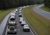 More than 1.5 million people were ordered to evacuate their homes in preparation. Vehicles lined up in heavy traffic (above) in Wallace, North Carolina on Tuesday