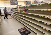 A store's bread shelves are bare as people stock up on food in Myrtle Beach, South Carolina on Tuesday ahead of the arrival of Hurricane Florence