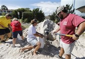 People fill sand bags in Isle of Palms, South Carolina on Monday as the state's entire coastline was ordered to prepare for mandatory evacuations