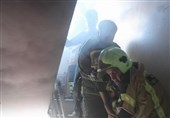 گرفتار شدن 5 نفر بر اثر آتشسوزی در ساختمان مسکونی + تصاویر