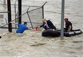Internet Goes Nuts over Fake Photo of Trump 'Rescuing' Flood Victims (+Photos)