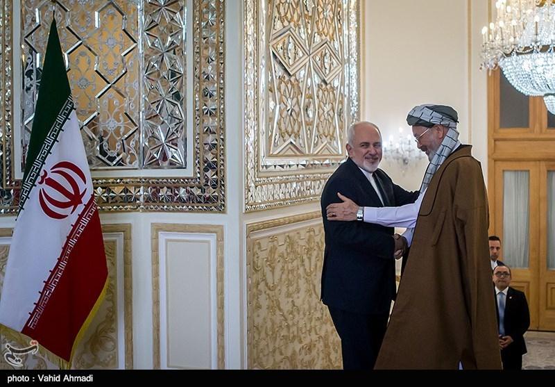 دیدار رئیس شورای عالی صلح افغانستان با ظریف