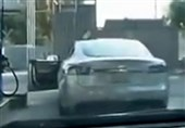 Video Shows Hilarious Moment Woman Tries to Fill Up Her Telsa Electric Car with Gas