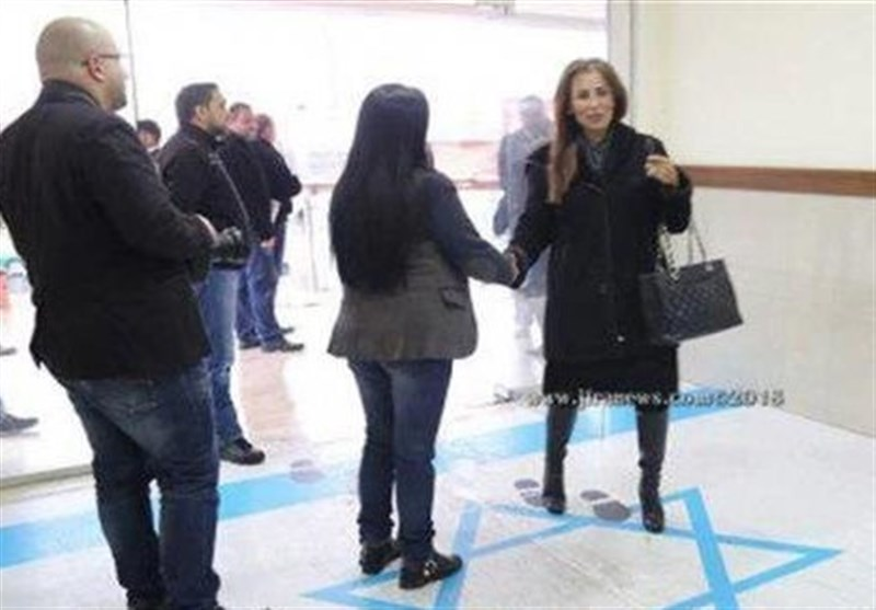 Israel Protests after Jordanian Spokeswoman Steps on Its Flag