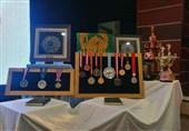قهرمان کشتی جهان 14 مدال خود را به موزه آستان قدس رضوی اهدا کرد