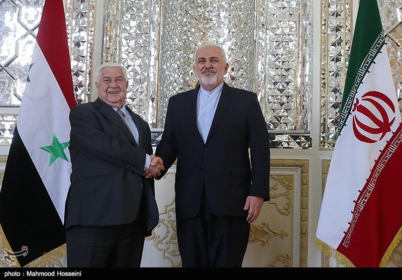محمدجواد ظریف و ولید معلم وزرای امور خارجه ایران و سوریه