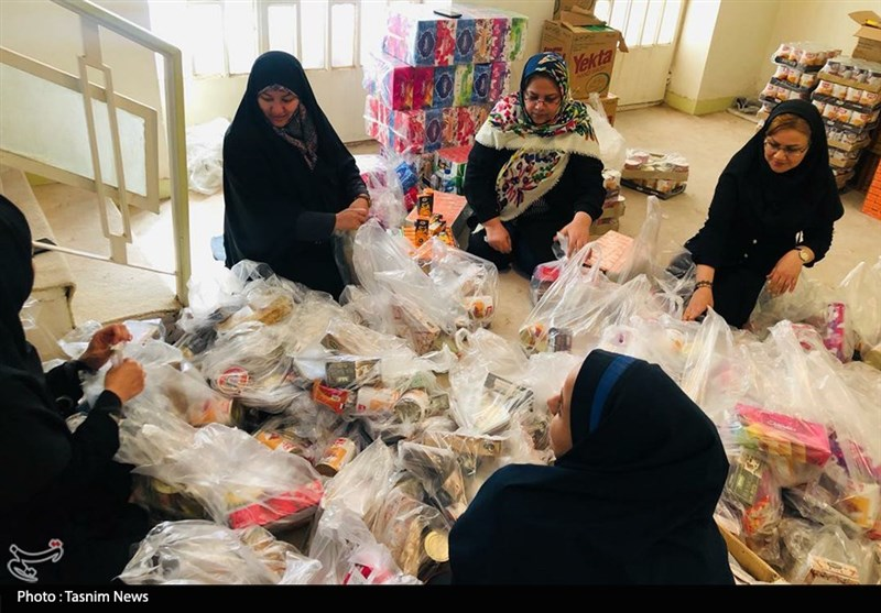 کمکرسانی بانوان خبرنگار به مردم سیلزده خوزستان + تصویر
