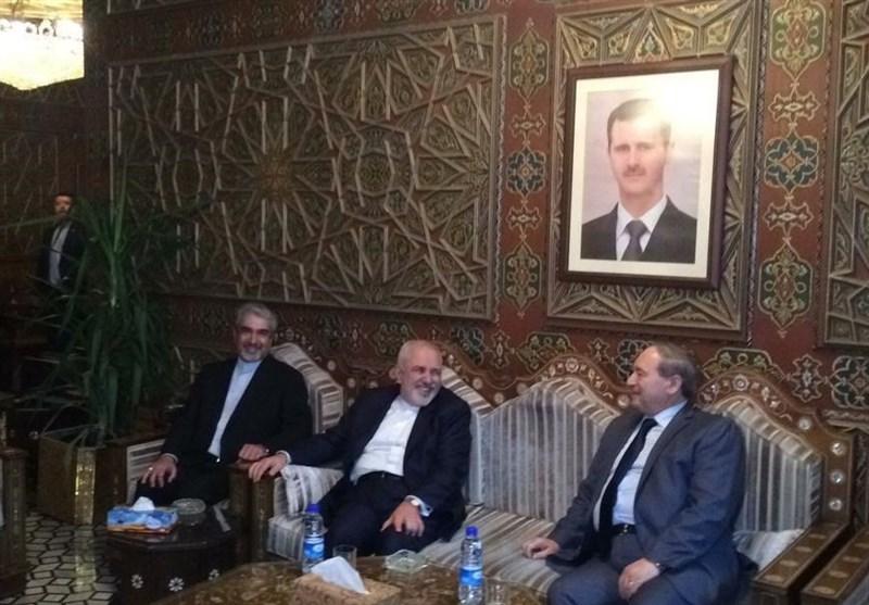 ظریف در فرودگاه دمشق: برای اجرای توافقات دو کشور به سوریه آمدهام