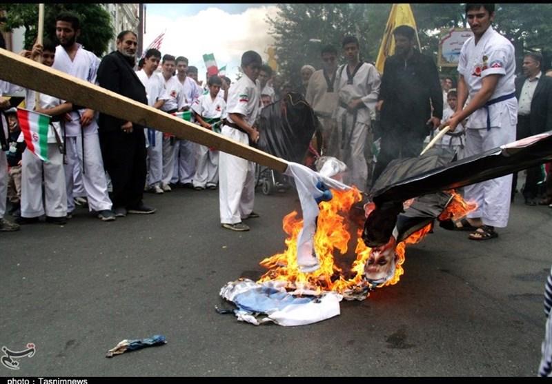 آسوشیتد پرس: تظاهراتکنندگان در ایران و عراق پرچمهای آمریکا و اسرائیل را به آتش کشیدند