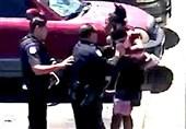 Disturbing Video Shows US Police Officer Aiming Gun at Black Family