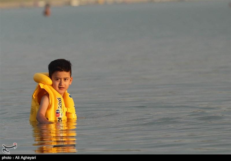 حضور گردشگران تابستانی در سد حسنلو نقده به روایت تصویر