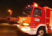 آتش سوزی پژو 206 روی پل صدر + تصاویر