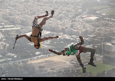 Iranian Military Commandoes Parachute from Milad Tower