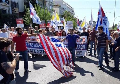الیونانیون یتظاهرون فی أثینا احتجاجاً على زیارة بومبیو
