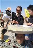 خدماترسانی فاطمیون به زائران اربعین در مرز مهران+عکس و فیلم