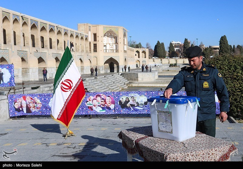 A police officer cast his vote in Isfahan