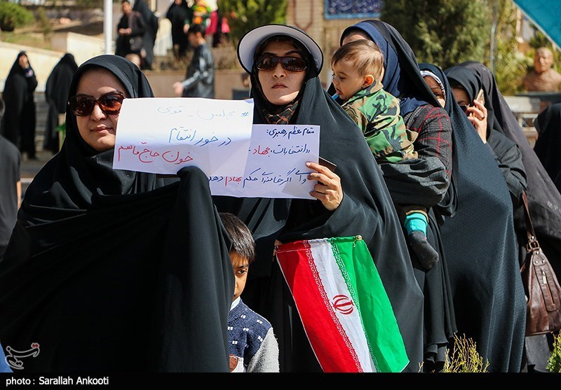 Women posed with signs before voting
