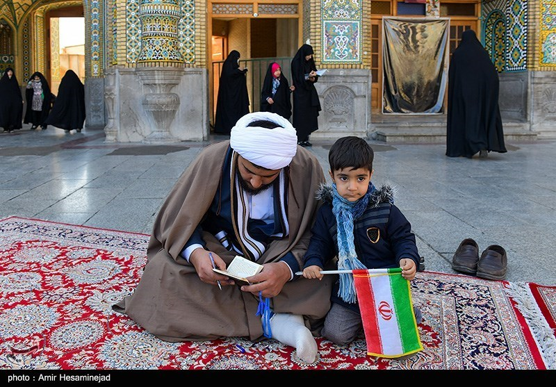 A man voted with his son in Qom