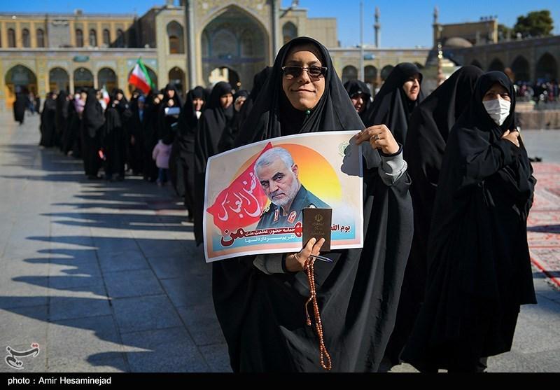 A woman held up a poster of slain the Qods Force commander Qassem Soleimani