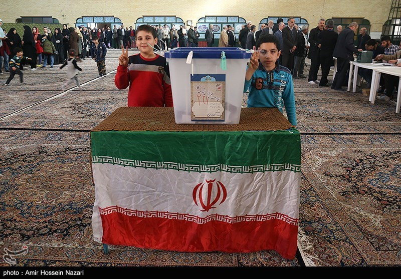 Children posed next to a ballot box in Qazvin
