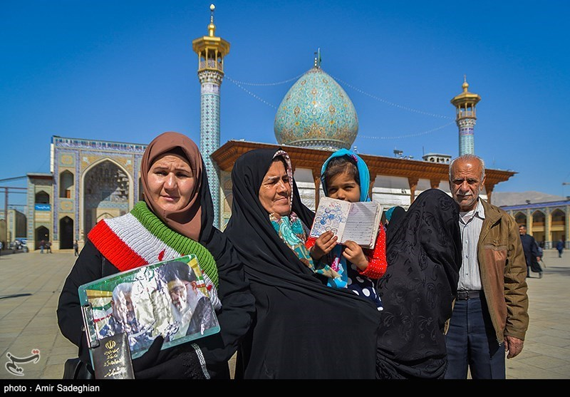People posed for a picture outside of a polling station in Shiraz