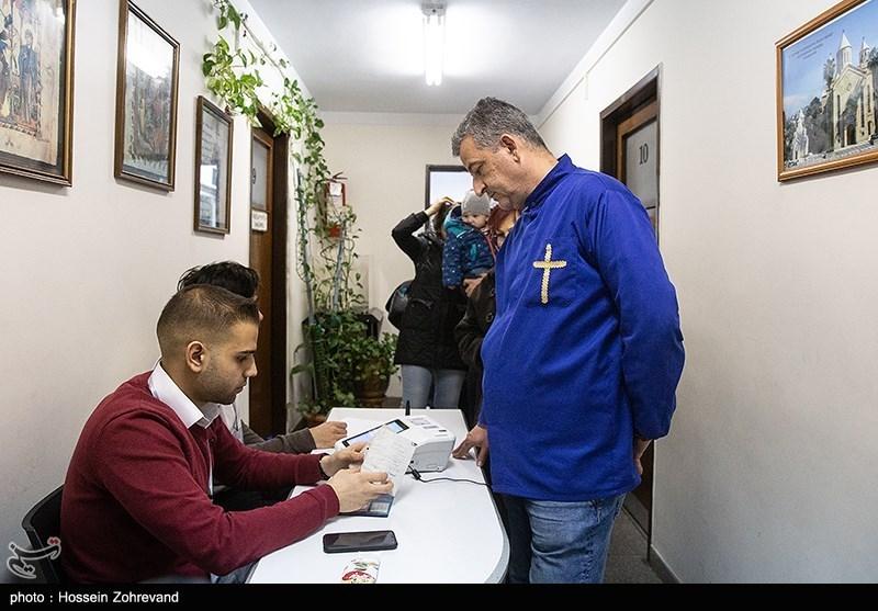 An Armenian Christian votes at a church in Tehran