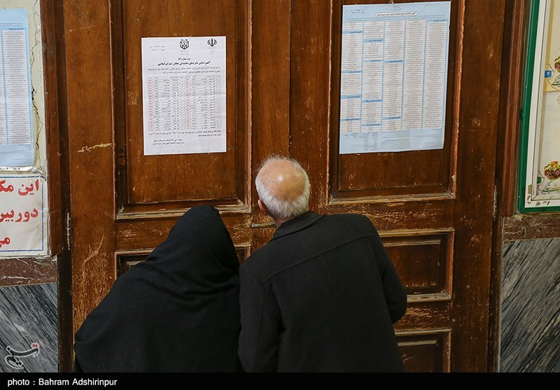 A couple reviewed an election board in Ardebil