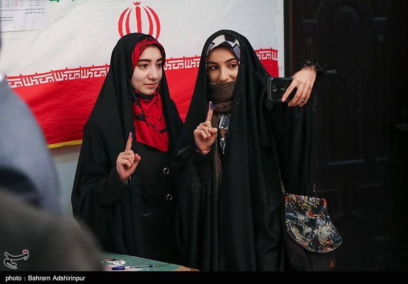 Young women posed for a picture while voting in Ardabil