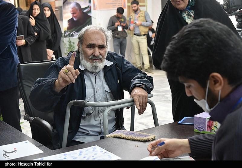 An elderly man votes in Birjand
