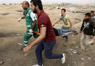 جرافات الاحتلال تنکل بجثمان شهید شرق خانیونس