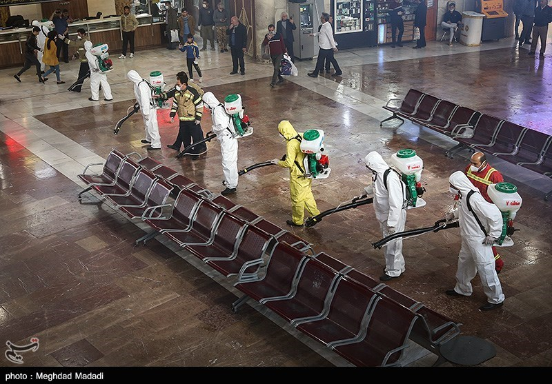 Workers sanitized Tehran's main bus hub.
