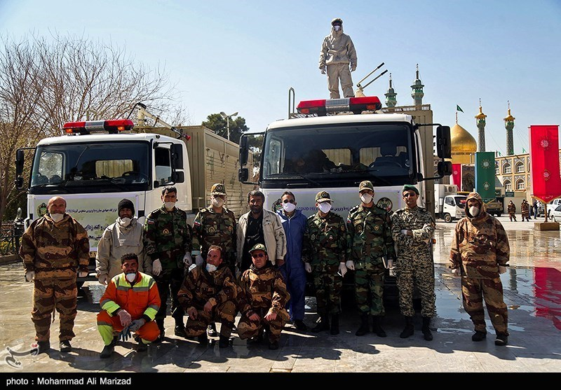 Military personnel prepared to disinfected holy sites in Qom.
