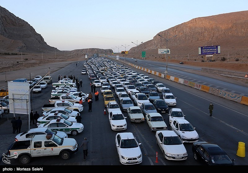 Cars stopped for screening near Isfahan on March 20.