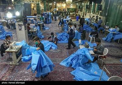تهران  تولید روزانه ۱۵۰۰ گان بیمارستاتی توسط خیرین منطقه ۱۹ + تصاویر