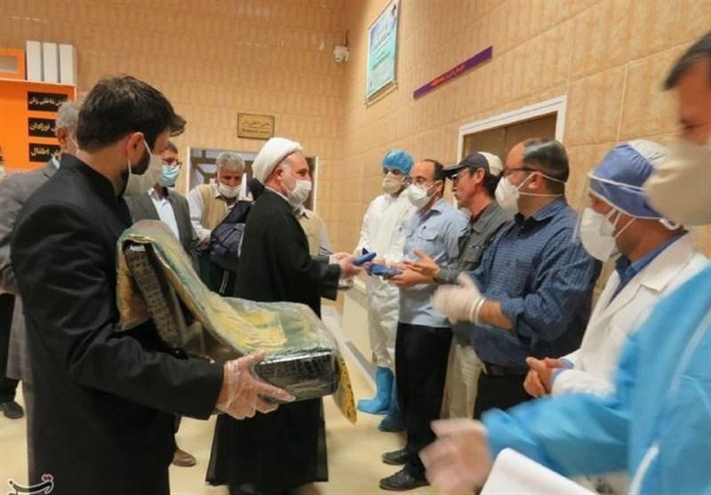 دخیل مدافعان سلامت کوهدشت به پرچم امام رئوف؛ خادمیاران رضوی در کنار بیماران کرونایی