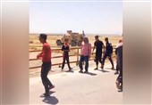 Syrian Kids Pelt US Military Convoy in Hasakah after Army Stops Vehicles (+Video)