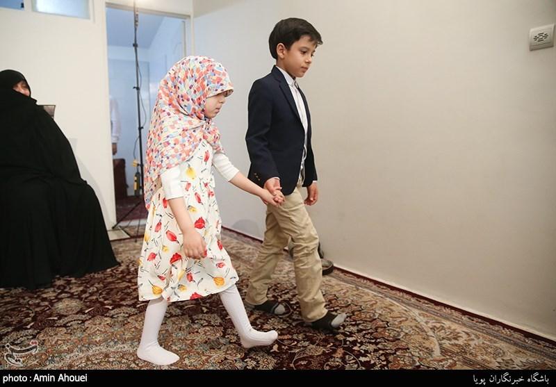 علی اکبر و زهرا الله کرم فرزندان شهید مدافع حرم جواد الله کرم