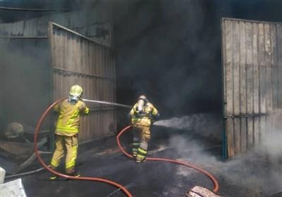 آتشسوزی گسترده انبار کالا در خیابان فدائیان اسلام + فیلم و تصاویر