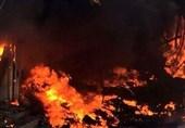 تداوم آتش سوزی 50 انبار مواد غذایی در نجف+عکس
