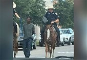 African-American Man Led by White Mounted Cops with Rope Suing Texas